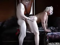 Nasty old bitch seduces a skinny youngster and fucks him senseless