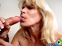 Mature hottie Kelly Ambrose fills her blissful mouth with a load of hot fresh cum from her guy!