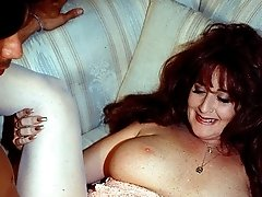 Sexy hot MILF enjoys fucking a hot young stud in bed