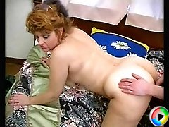 Horny milf in guy's bedroom