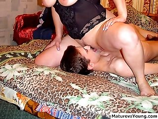 Horny old bitch satisfies her appetite for big hard young dick