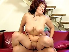 Insatiable milf punishes her clumsy lover-boy
